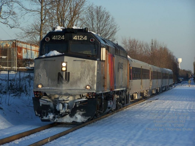 Westbound New Jersey Transit F40 4124 arrives in Hammonton in late afternoon sunset on March 4, 2009. Photo by Thomas Duke.
