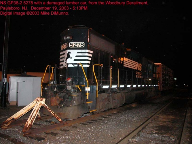 NS power at Paulsboro, with damaged lumber car from CA-11 derailment.