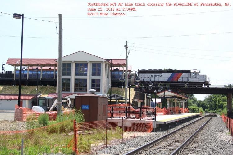 NJT AC Line train crosses overhead the still under construction Pennsauken transfer station in Pennsauken, NJ.